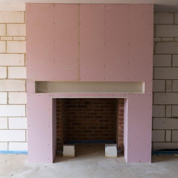 Dry lining around fireplace